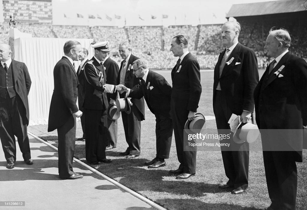 King George VI (1895 - 1952, centre, left) greeting members of the International Olympic Committee during the opening ceremony of the London Olympics at Wembley Stadium, 29th July 1948.