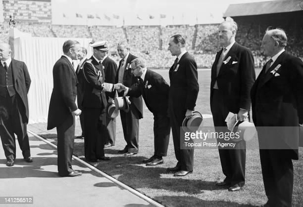 King George VI greeting members of the International Olympic Committee during the opening ceremony of the London Olympics at Wembley Stadium 29th...