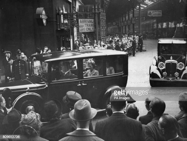 King George VI Princess Elizabeth and Princess Margaret in the royal car leaving Euston Station after arriving back in London from Balmoral
