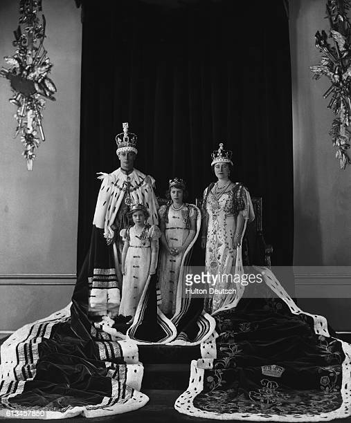 King George VI Queen Elizabeth and Princesses Elizabeth and Margaret pose as a family on the King's coronation day May 12 1937