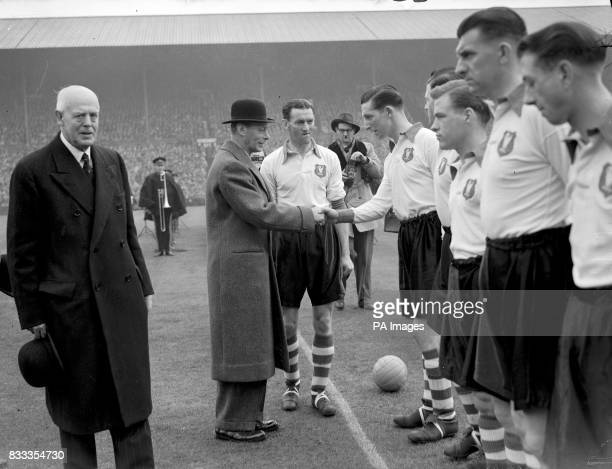 HRH King George VI shakes hands with the Liverpool team Captain Phil Taylor Bill Jones Kevin Baron Eddie Spicer and Laurie Hughes