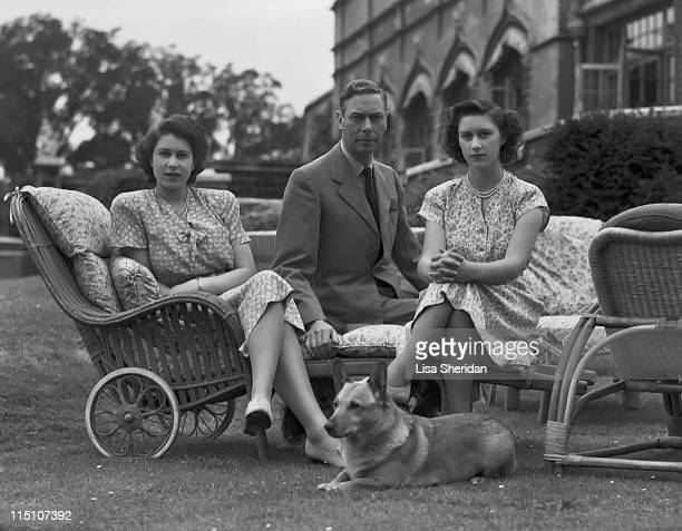 King George VI with his daughters Princess Elizabeth and Princess Margaret in the grounds of Windsor Castle in Windsor England on July 08 1946