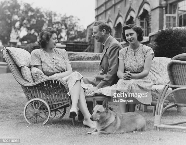 King George VI with his daughters Princess Elizabeth and Princess Margaret in the grounds of the Royal Lodge in Windsor England on July 08 1946