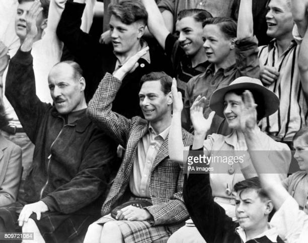 King George VI with Queen Elizabeth at the King's public schoolboys and industrial lad's camp which is usually held annually at Southwold is being...