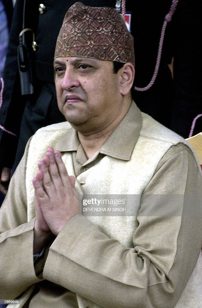 King Gyanendra of Nepal greets the crowd during the Goa Dan ceremony at the Narayanhity Royal Palace in Kathmandu, 15 January 2004. Opposition parties and student groups in Nepal have been staging street protests for months against King Gyanendra after he dismissed prime minister Sher Bahadur Deuba in October 2002, accusing him of incompetence in tackling an increasingly deadly Maoist revolt that has claimed more than 8,300 lives since 1996 and deepened the nation's economic woes.