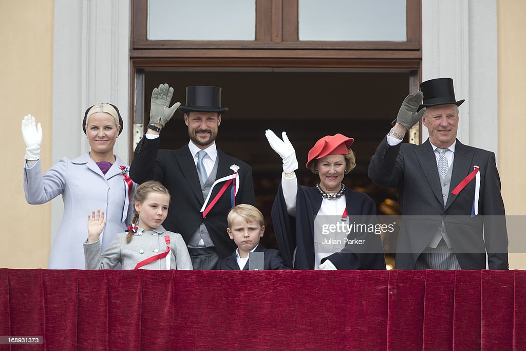 King Harald and Queen Sonja, and Crown Prince Haakon, and <a gi-track='captionPersonalityLinkClicked' href=/galleries/search?phrase=Crown+Princess+Mette-Marit&family=editorial&specificpeople=171288 ng-click='$event.stopPropagation()'>Crown Princess Mette-Marit</a> of Norway, Prince Sverre Magnus, and <a gi-track='captionPersonalityLinkClicked' href=/galleries/search?phrase=Princess+Ingrid+Alexandra&family=editorial&specificpeople=243087 ng-click='$event.stopPropagation()'>Princess Ingrid Alexandra</a>, watch the annual Norwegian National Day parade from the balcony of The Royal Palace in Oslo on May 17, 2013 in Oslo, Norway.