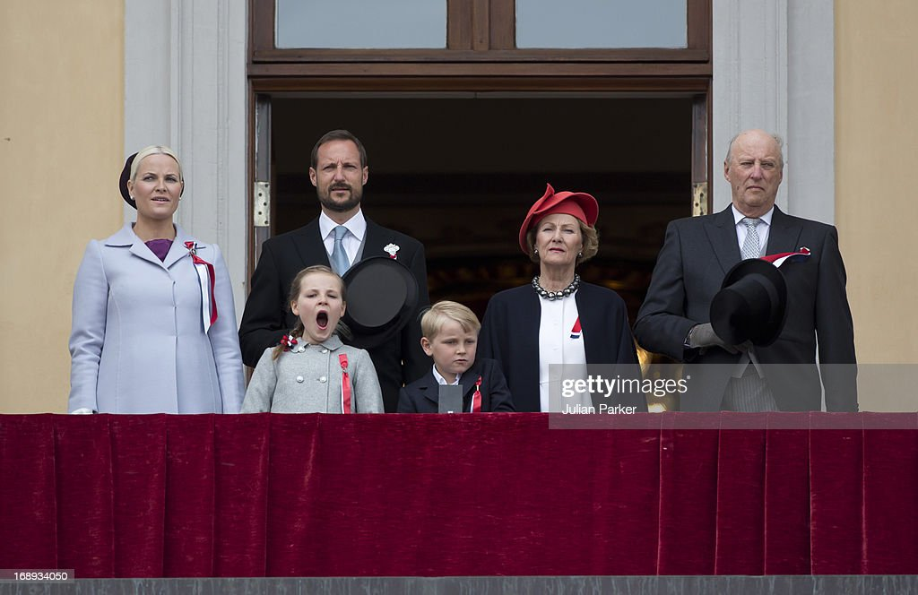 King Harald and Queen Sonja, Crown Prince Haakon, <a gi-track='captionPersonalityLinkClicked' href=/galleries/search?phrase=Crown+Princess+Mette-Marit&family=editorial&specificpeople=171288 ng-click='$event.stopPropagation()'>Crown Princess Mette-Marit</a> of Norway, Prince Sverre Magnus and <a gi-track='captionPersonalityLinkClicked' href=/galleries/search?phrase=Princess+Ingrid+Alexandra&family=editorial&specificpeople=243087 ng-click='$event.stopPropagation()'>Princess Ingrid Alexandra</a> watch the annual Norwegian National Day parade from the balcony of The Royal Palace in Oslo on May 17, 2013 in Oslo, Norway.