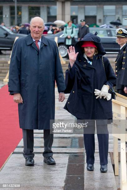 King Harald of Norway and Queen Sonja of Norway leave to host a lunch on the Norwegian Royal Yacht 'Norge' as part of the celebrations of their 80th...