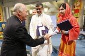 King Harald of Norway congratulates the 2014 Nobel Peace prize laureates India's Kailash Satyarthi and Pakistan's Malala Yousafzai after the Nobel...