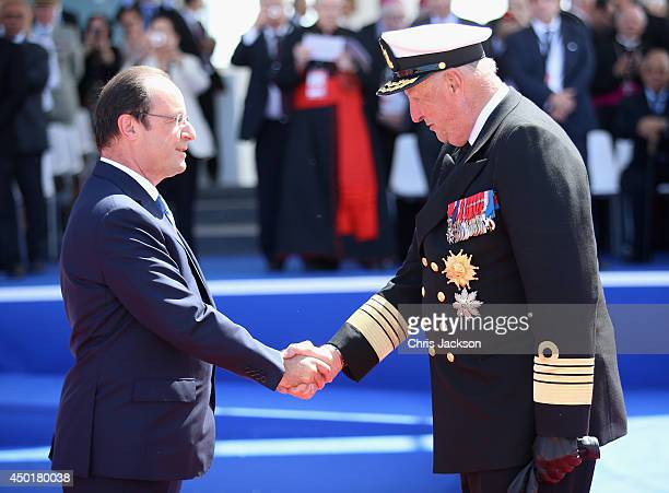 King Harald of Norway greets Francois Hollande as he attends a Ceremony to Commemorate DDay 70 on Sword Beach on June 6 2014 in Ouistreham France...