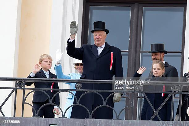 King Harald of Norway with his grandchildren Prince Sverre Magnus and Princess Ingrid Alexandra of Norway on the balcony of The Royal Palace in Oslo...
