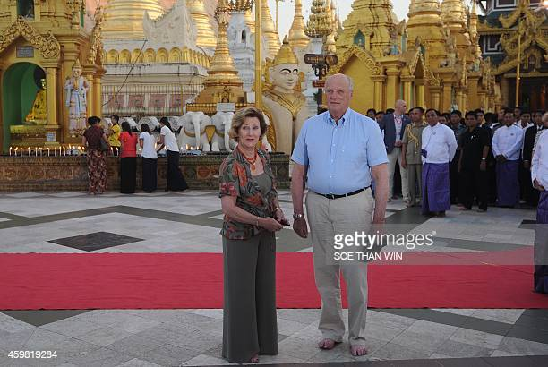 King Harald V of Norway and Queen Sonja pose for photos as they tour Myanmar landmark Shwedagon pagoda in Yangon on December 2 2014 King Harald V and...