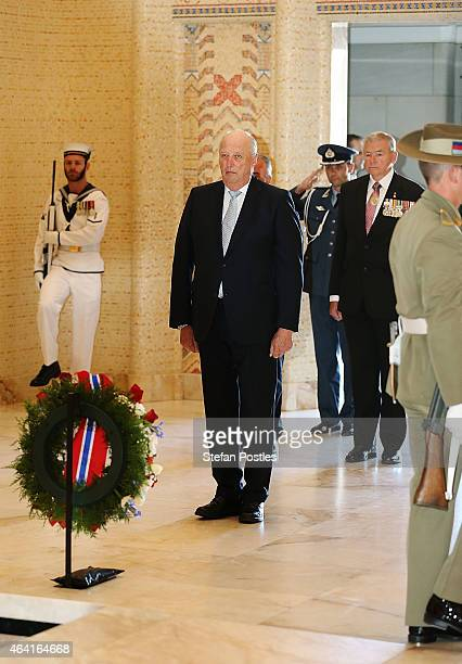 King Harald V of Norway lays a wreath at the Tomb of the Unknown Soldier during a visit to the Australian War Memorial on February 23 2015 in...