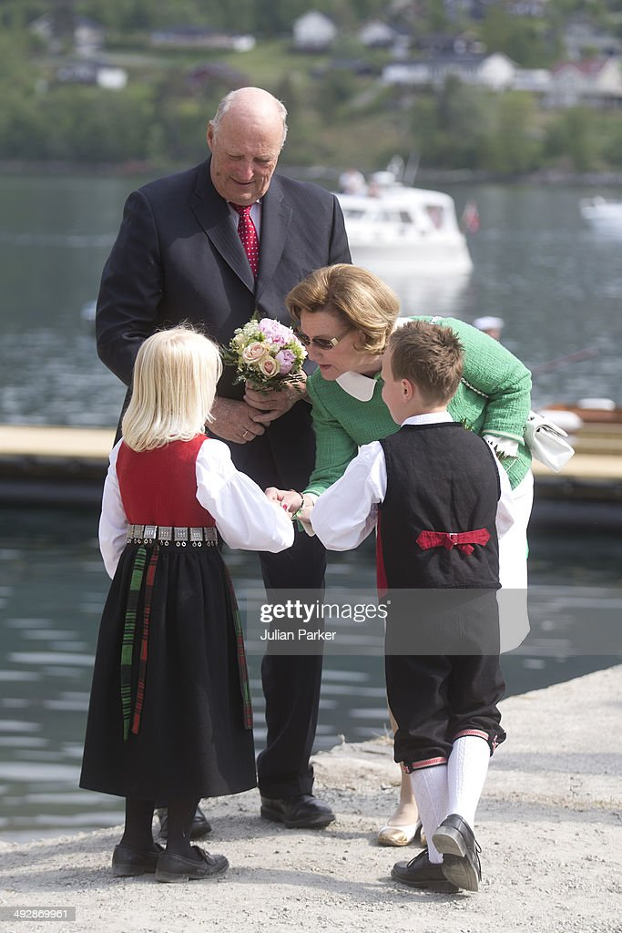 King Harlad of Norway and Queen Sonja of Norway are greeted by two young children during their visit to the community of Tingvoll on May 21, 2014 in More And Romsdal County, Norway. King Harald And Queen Sonja Of Norway are on a two day visit of the county of More & Romsdal in Norway.