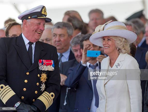 King Harold of Norway speaks to Camillla Duchess of Cornwall at a ceremony to Commemorate DDay 70 on Sword Beach during DDay 70 Commemorations on...