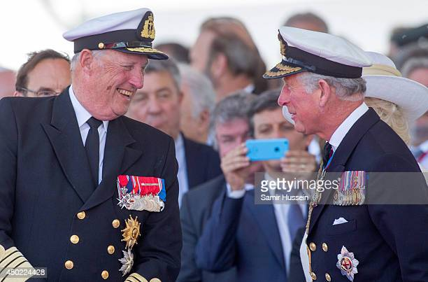King Harold of Norway speaks to Prince Charles Prince of Wales at a Ceremony to Commemorate DDay 70 on Sword Beach during DDay 70 Commemorations on...