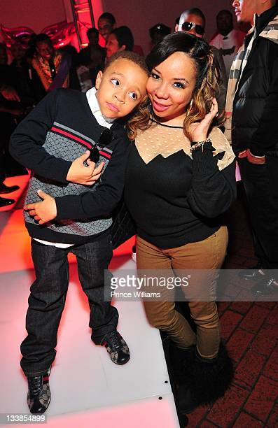 King Harris and Tameka 'Tiny' Harris attend Reginae Carter's 13th Birthday party at The Callanwolde Mansion on November 19 2011 in Atlanta Georgia
