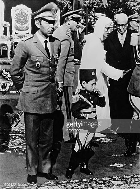 King Hassan II of Morocco with his son Crown Prince Sidi Mohammed at a military parade to celebrate Moroccan independence Morocco 18th November 1967