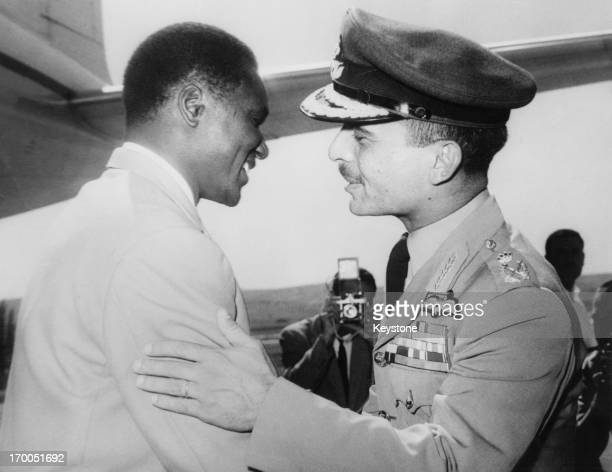 King Hussein greets President of Guinea Ahmed Sekou Toure at Amman Airport Jordan 17th October 1964 President Sekou Toure is in Jordan for a two day...