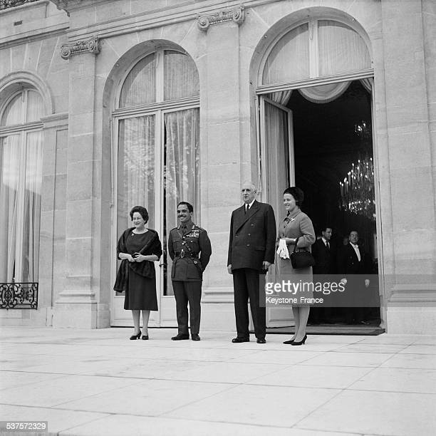 King Hussein of Jordan and his wife Mouna are received by the President of the Republic Charles de Gaulle and his wife Yvonne on November 18 1964 in...