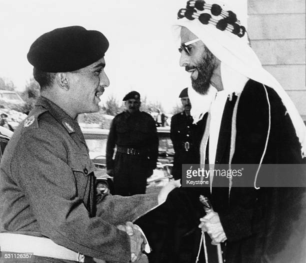 King Hussein of Jordan greets Sheikh Shakhbut bin Sultan Al Nahyan the ruler of Abu Dhabi upon his arrival at the Officers' Club in Zerqa Jordan...