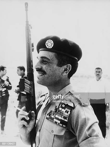 King Hussein of Jordan holding an automatic weapon whilst taking part in a live fire exercise at a rifle range of the Royal Guards Brigade in Jordan...