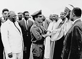 King Hussein of Jordan is welcomed by officials upon his arrival in Khartoum to attend the Arab League Summit Sudan August 1967 The summit was held...