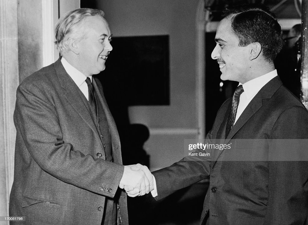 King Hussein of Jordan (1935 - 1999) (right) shakes hands with Prime Minister Harold Wilson (1916 - 1995) after the pair had lunch at 10 Downing Street earlier today, London, 16th December 1964.