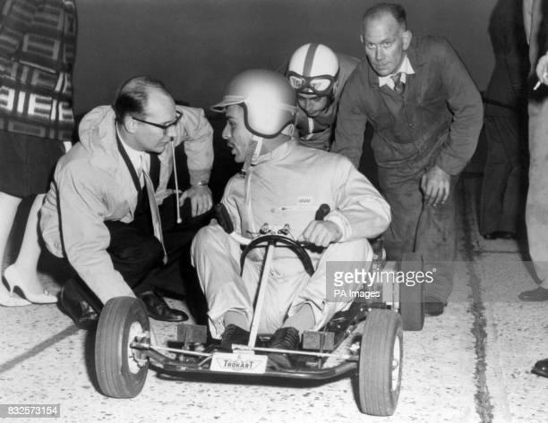 King Hussein of Jordan talks to Trokart sales manager David McMullan before the start of a tenlap gokart race at Biggin Hill RAF Station