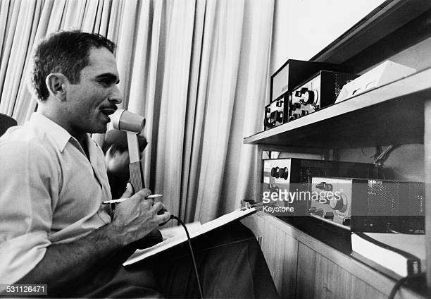 King Hussein of Jordan uses the amateur radio equipment given to him on his birthday by his wife Princess Muna alHussein Jordan 1970 The king is a...
