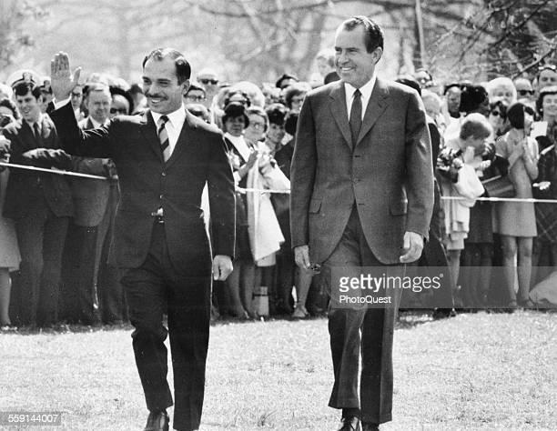 King Hussein of Jordan waves as he walks with US President Richard Nixon during a State Visit Washington DC 1969