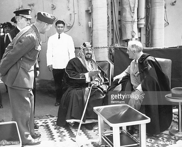 King Ibn Sa'ud of Saudi Arabia converses with President Franklin Delano Roosevelt on board a ship returning from the Yalta Conference in 1945