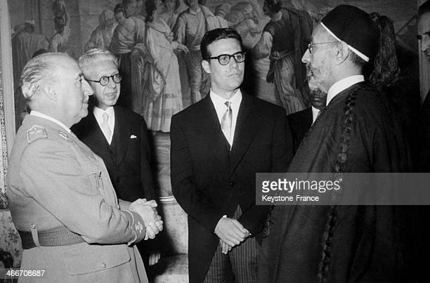 King Idris of Libya is seen chatting with general Francisco Franco in the fifties