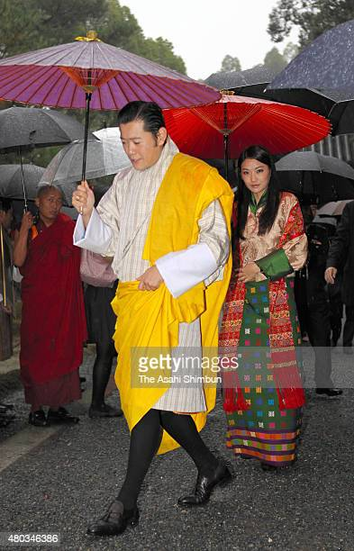 King Jigme Khesar Namgyel Wangchuck and Queen Jetsun Pema of Bhutan talk visit Kinkakuji Temple on November 19 2011 in Kyoto Japan