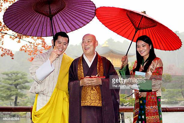 King Jigme Khesar Namgyel Wangchuck and Queen Jetsun Pema of Bhutan talk with Buddhist monk Raitei Arima at Kinkakuji Temple on November 19 2011 in...