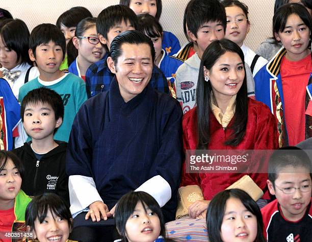 King Jigme Khesar Namgyel Wangchuck and Queen Jetsun Pema of Bhutan pose for photographs with local children as they visit nulcear devastated...