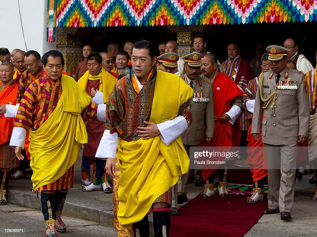 King <a gi-track='captionPersonalityLinkClicked' href=/galleries/search?phrase=Jigme+Khesar+Namgyel+Wangchuck&family=editorial&specificpeople=737466 ng-click='$event.stopPropagation()'>Jigme Khesar Namgyel Wangchuck</a>, arrives at the Tashichho Dzong before an early prayer morning ceremony at the Chamber of the Golden Throne for the the new Royal couple,October 15, 2011 in Thimphu, Bhutan. In this final day of wedding celebrations for the royal couple more than 50,000 people turned up at the stadium to see dancing and singing.