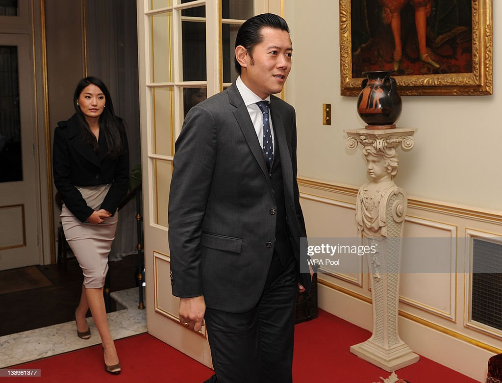 King Jigme Khesar Namgyel Wangchuk (R) and Queen Jetsun Pema Wangchuk of Bhutan (L) arrive at Clarence House on November 23, 2011 in London, England.