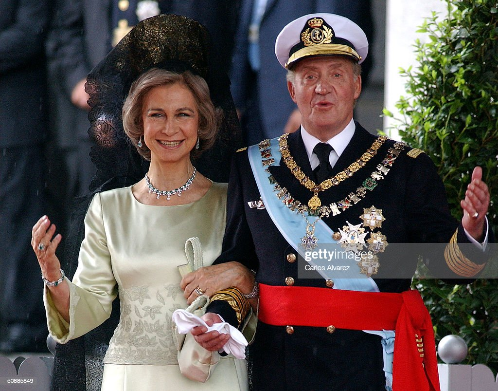 King Juan Carlos and Queen Sofia of Spain leave after they attended the wedding ceremony between Spanish Crown Prince Felipe de Bourbon and former journalist Letizia Ortiz at the Almudena cathedral May 22, 2004 in Madrid.