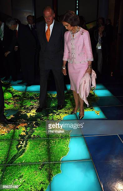 King Juan Carlos and Queen Sofia of Spain walks over a map of New Zealand at the Museum of New Zealand Te Papa Tongarewa during a visit to New...