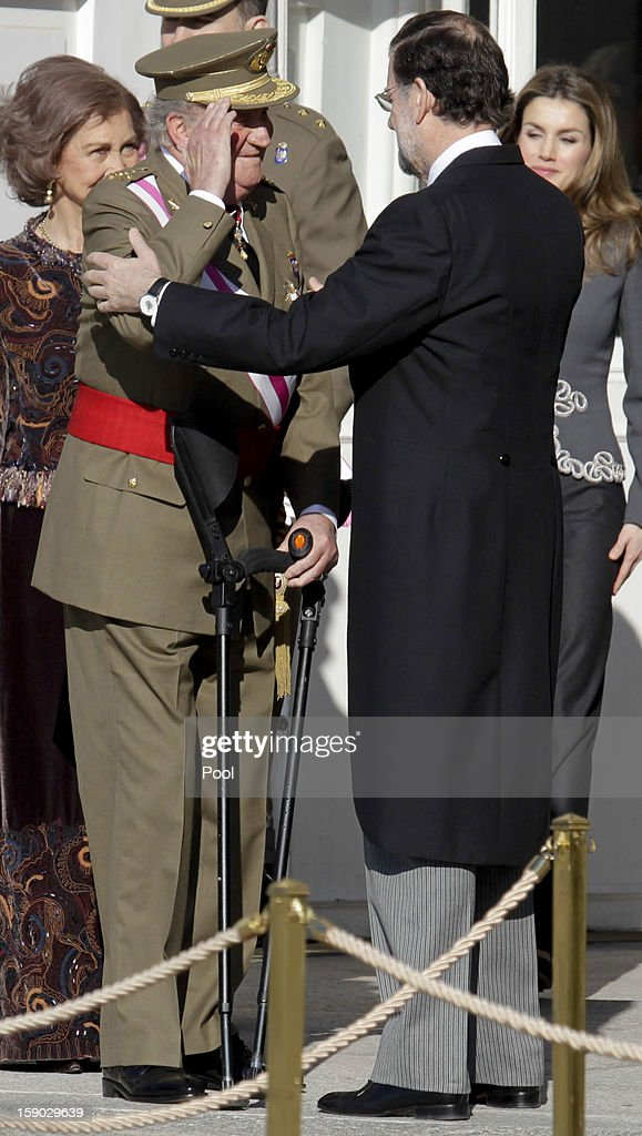 King Juan Carlos I (L) and President of the Government of Spain Mariano Rajoy (R) attends new year's military parade at Royal Palace on January 6, 2013 in Madrid, Spain.