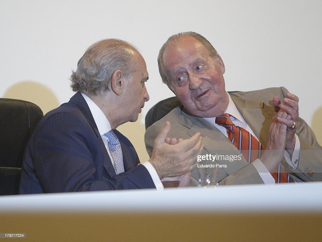 King <a gi-track='captionPersonalityLinkClicked' href=/galleries/search?phrase=Juan+Carlos+I&family=editorial&specificpeople=159452 ng-click='$event.stopPropagation()'>Juan Carlos I</a> of Spain (R) and Minister of Interior Jorge Fernandez Diaz attend delivery of La Caixa scholarships at Caixaforum on July 10, 2013 in Madrid, Spain.