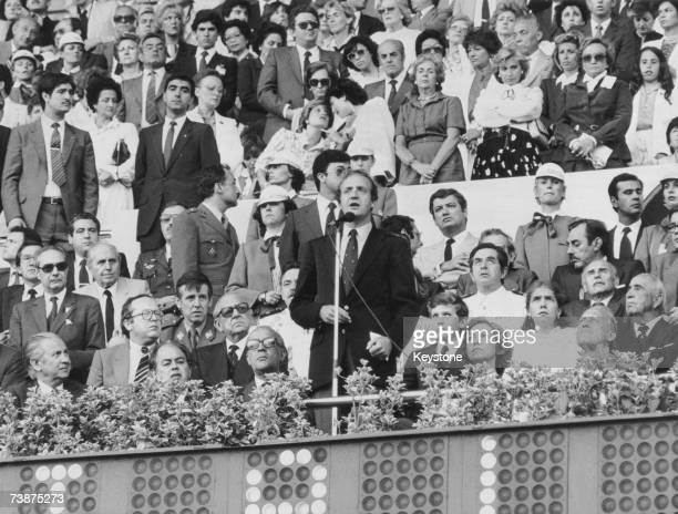 King Juan Carlos I of Spain delivers the opening speech of the World Cup at the Nou Camp stadium in Barcelona 13th June 1982 From left to right Juan...