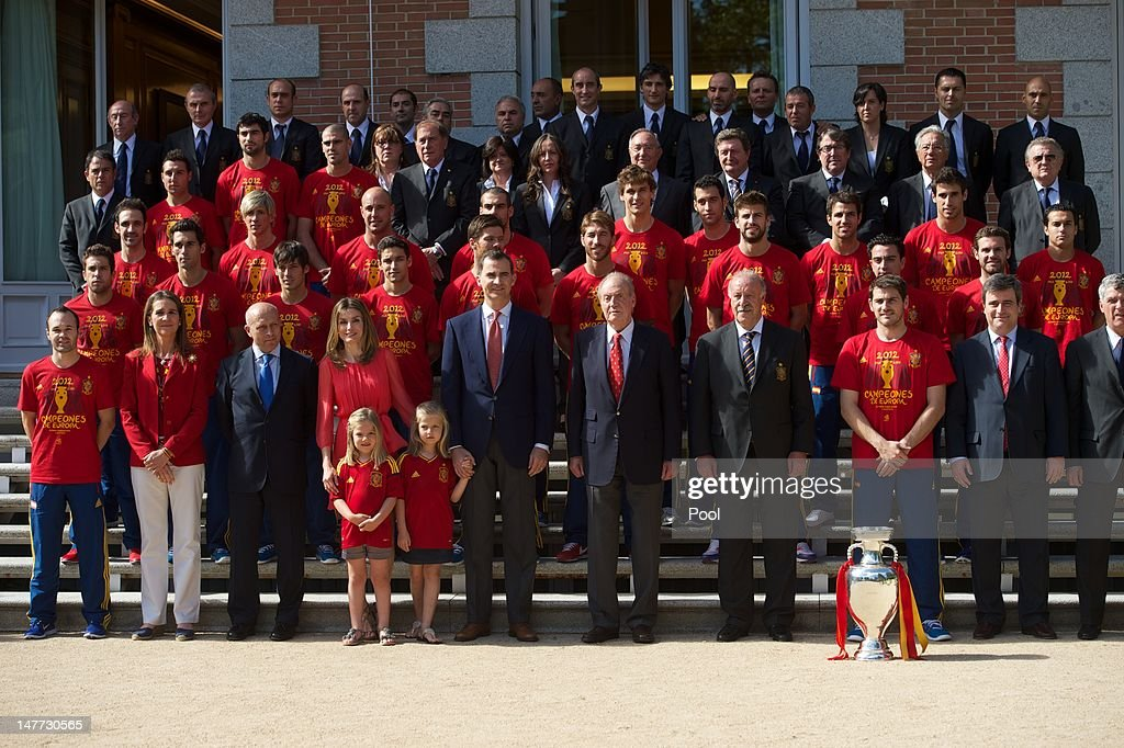 King Juan Carlos I of Spain (C) poses with members of the Spanish Royal family, members of Spain's victorious national football team and the UEFA EURO 2012 trophy at Zarzuela Palace on July 2, 2012 in Madrid, Spain.