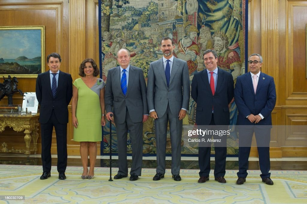 King Juan Carlos of Spain (3L) and Prince Felipe of Spain (3R) receive Regional President Ignacio Gonzalez (L), Mayor of Madrid <a gi-track='captionPersonalityLinkClicked' href=/galleries/search?phrase=Ana+Botella&family=editorial&specificpeople=235432 ng-click='$event.stopPropagation()'>Ana Botella</a> (2L), Secretary of State for Sport Miguel Cardenal (2R) and President of the Spanish Olympic Committee Alejandro Blanco (R) at the Zarzuela Palace on September 10, 2013 in Madrid, Spain.