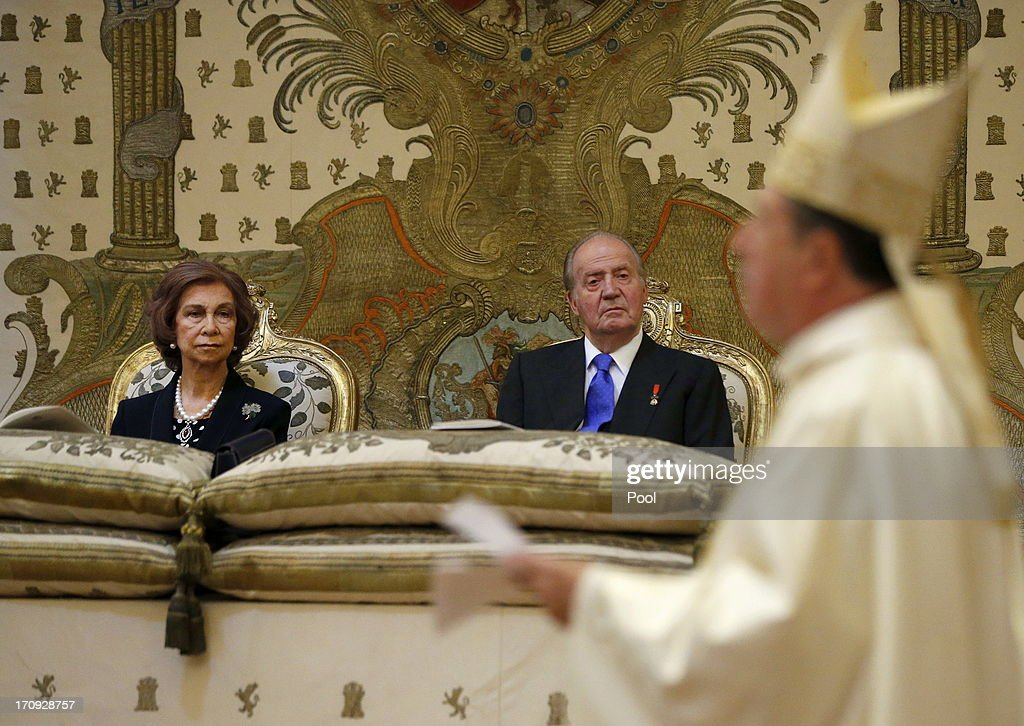 King Juan Carlos of Spain (R) and <a gi-track='captionPersonalityLinkClicked' href=/galleries/search?phrase=Queen+Sofia+of+Spain&family=editorial&specificpeople=160333 ng-click='$event.stopPropagation()'>Queen Sofia of Spain</a> are seen at the Mass commemorating the centenary of the birth of Don Juan de Borbon in the chapel of the Royal Palace in Madrid, Spain on June 20, 2013. The mass was attended by the Prince of Asturias, Spain's Prime Minister Mariano Rajoy, and other senior government officials.