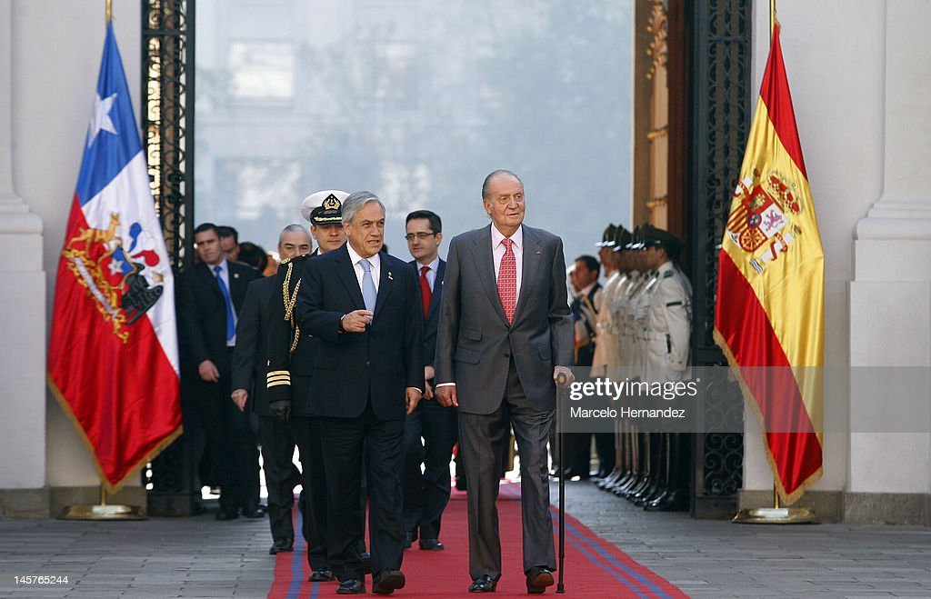 King Juan Carlos of Spain and the President of Chile Sebastián Piñera walk into the Presidential Palace La Moneda on June 5, 2012 in Santiago, Chile.