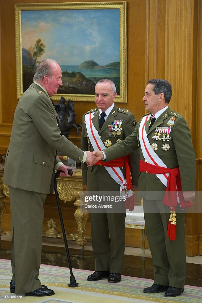 King Juan Carlos of Spain (L) attends several audiences at Zarzuela Palace on July 2, 2013 in Madrid, Spain.