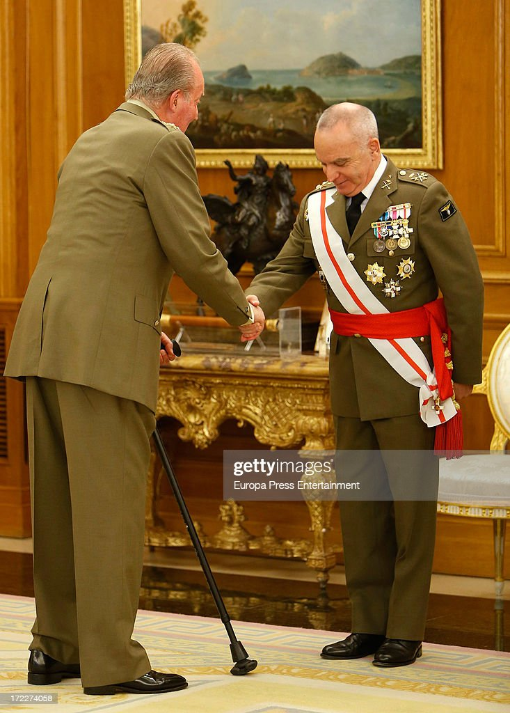 King Juan Carlos of Spain (L) attends several military audiences at Zarzuela Palace on July 2, 2013 in Madrid, Spain. For the first time in months, the King is seen walking with only one crutch.