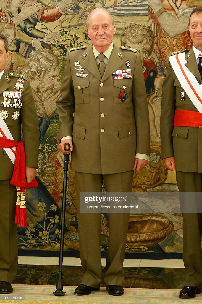 King Juan Carlos of Spain (C) attends several military audiences at Zarzuela Palace on July 2, 2013 in Madrid, Spain. For the first time in months, the King is seen walking with only one crutch.